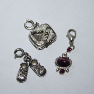 Lot of three silver charms
